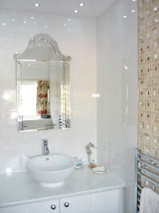 The sink of the en-suite is illuminated by multiple spots twinkling above.
