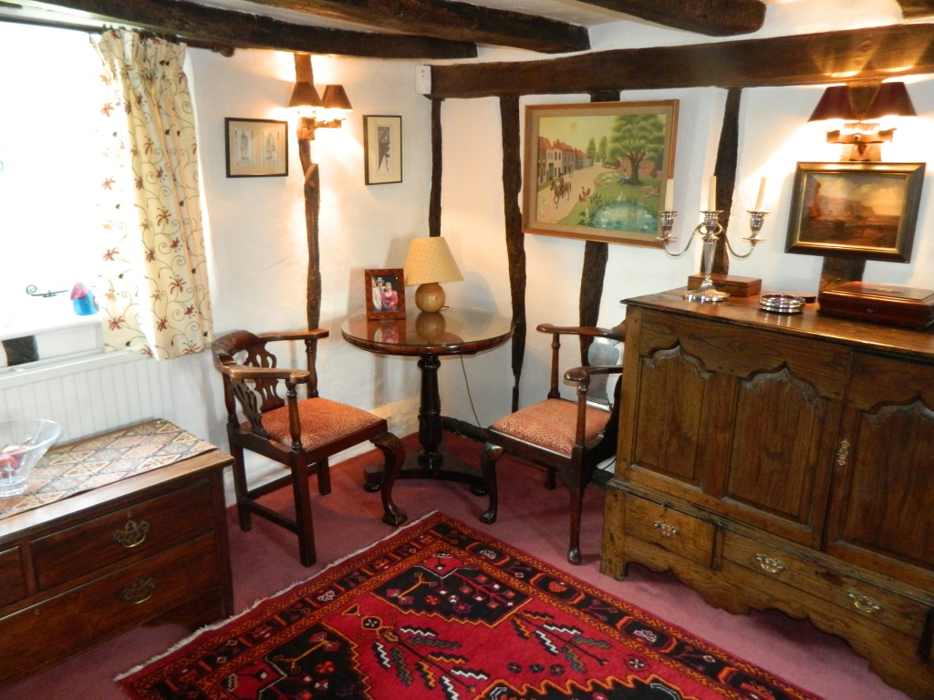 Cosy sitting room furnished with antiques, for exclusive use of our guests.