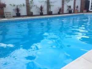The heated outdoor pool in a private courtyard for guests to use.