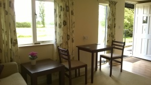 The Interior of Garden Room 1 has table chairs, a sofabed for additional accommodation (by prior agreement), tv, fridge, microwave, kettle, iron and board to make your stay more comfortable.